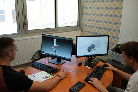 2 men working on 3D models